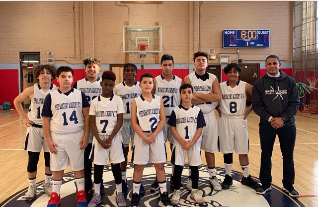 Boys basketball team with coach Mr. Gomez