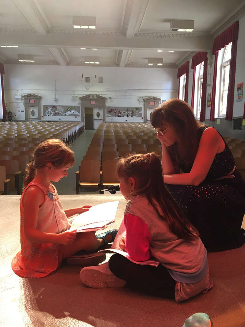 Students share their writing with the assistant principal
