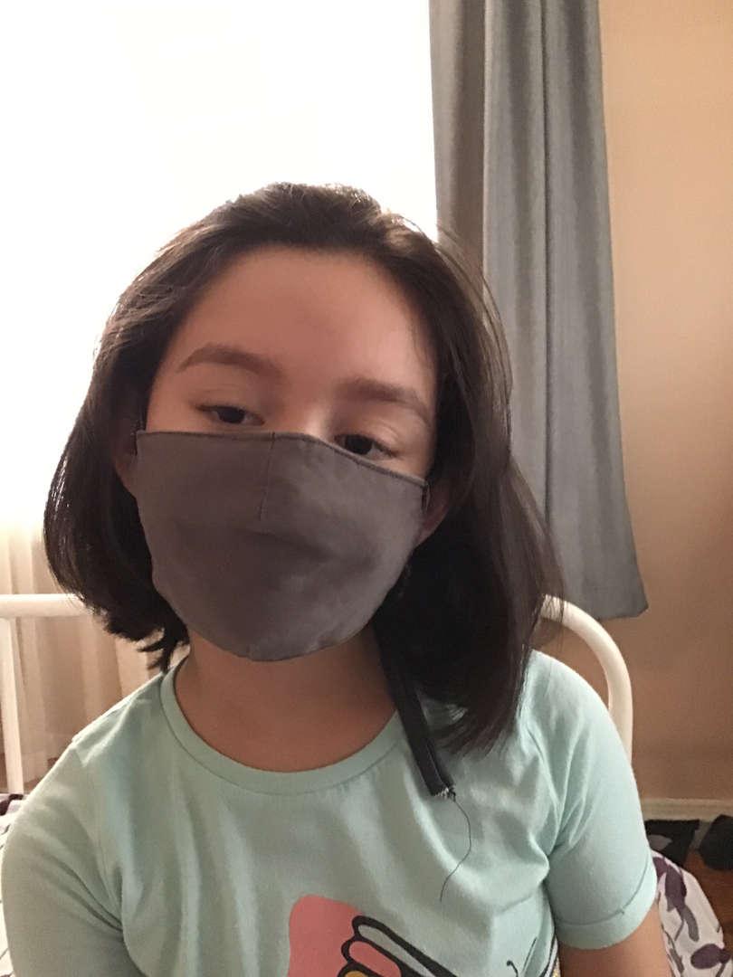 Student following mask mandate