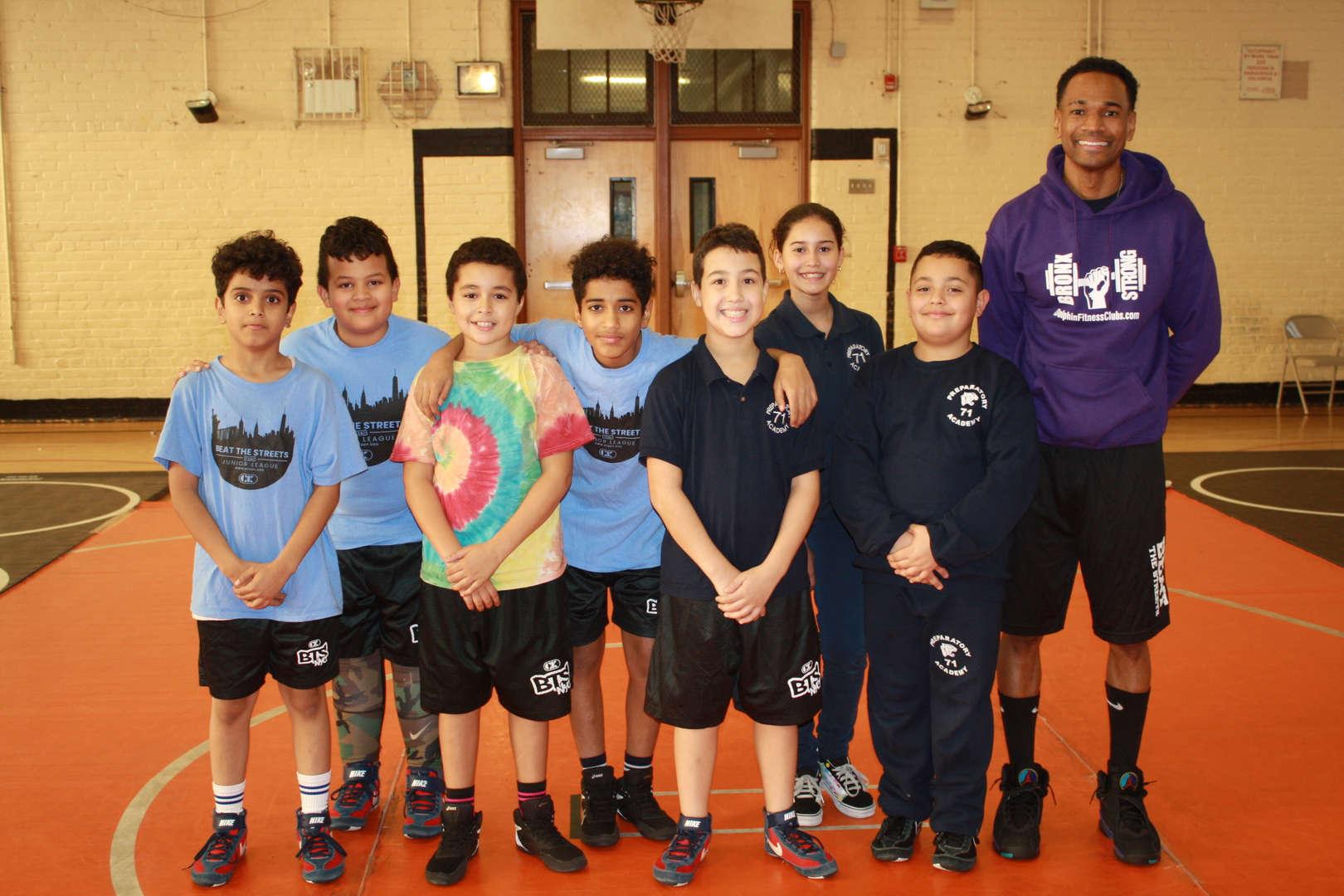 PS 71 Wrestling Team Photo with coach Mr. DeSaque