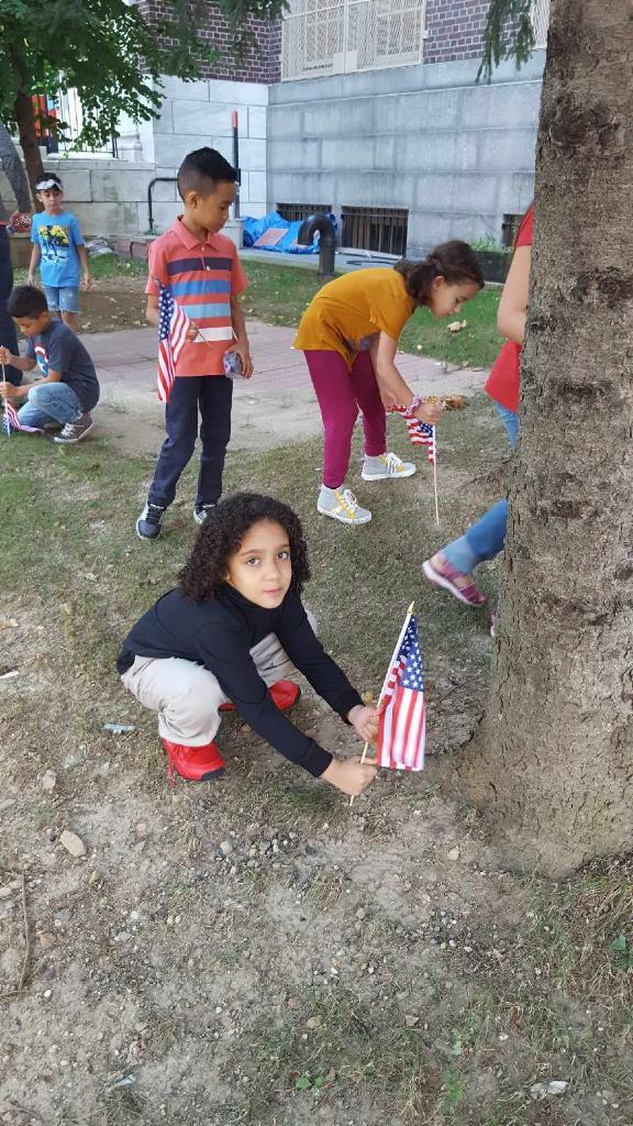 students place flags in our front garden as a 9/11 remembrance