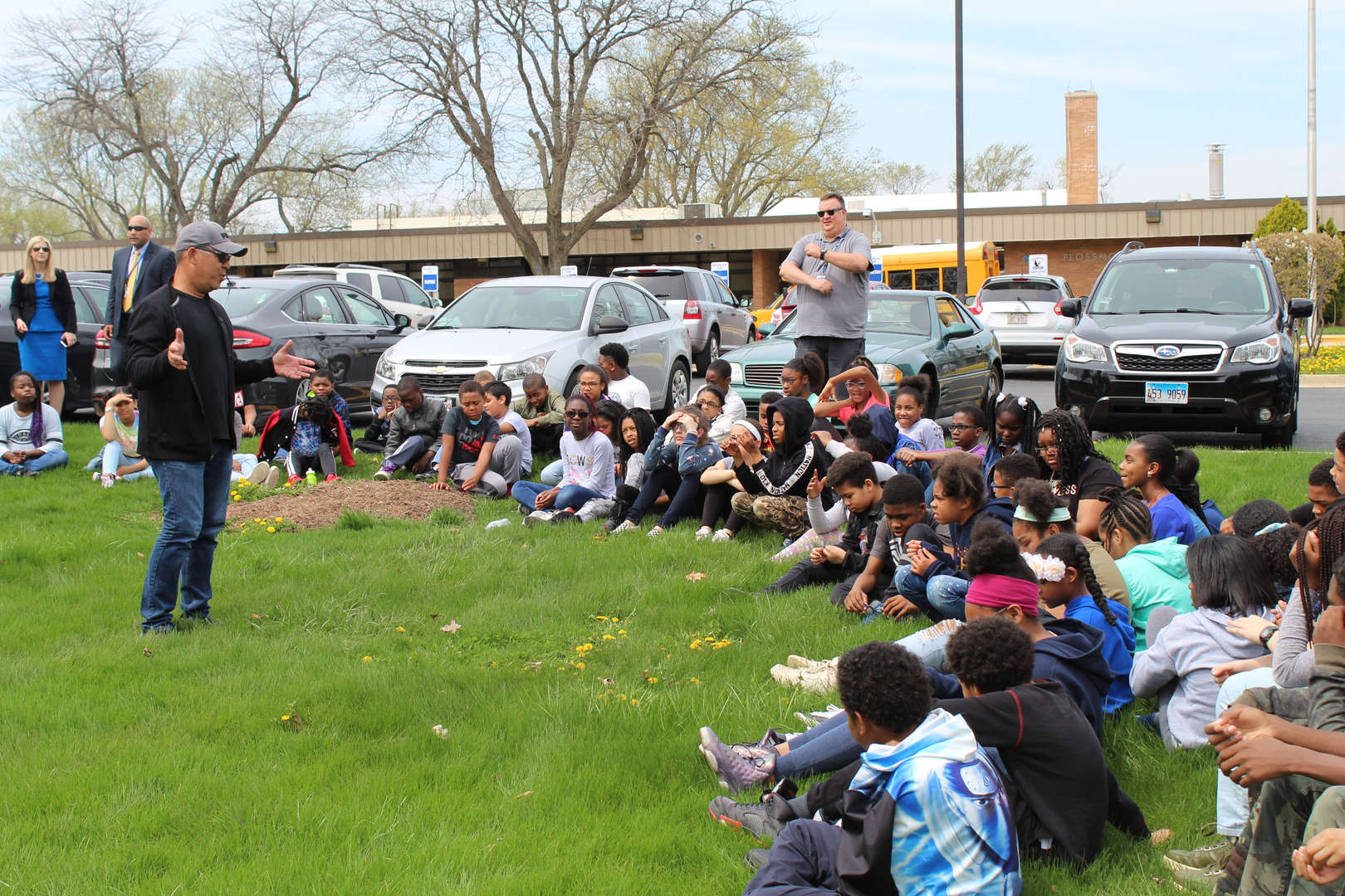 Artist Luis Kaiulani speaks to students at Flossmoor Hills after installing his sculpture, Yellow Flat-Line