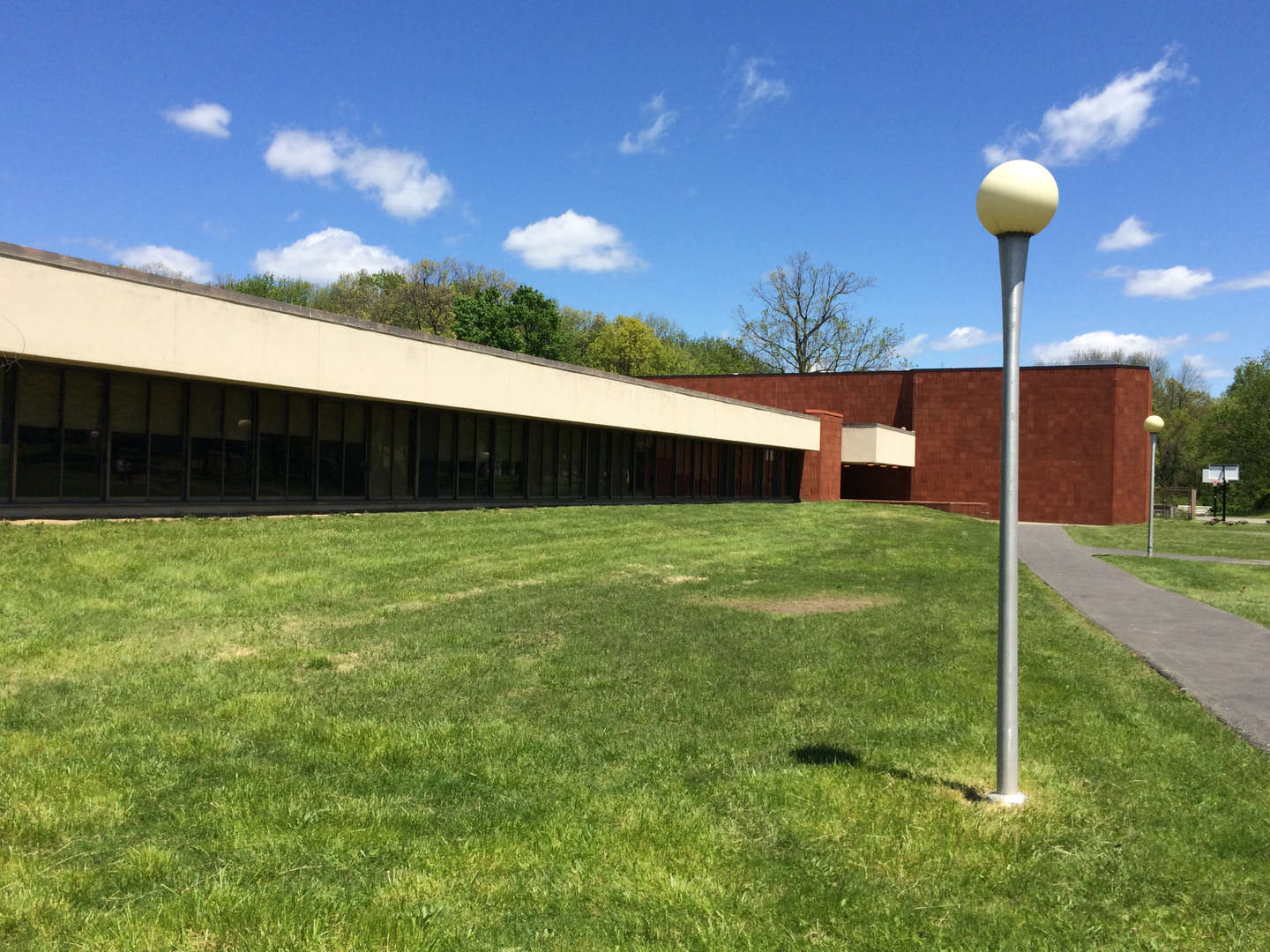 View of Edenwald School with light post.