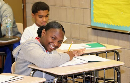 girl smiling at camera during class