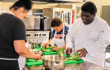 students preparing food in Culinary Arts classroom