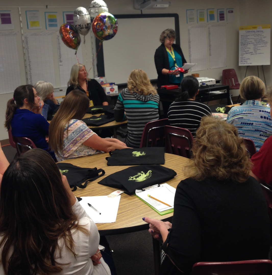 Desert View Elementary Principal, Barbara Rezzonico, celebrates the award of a School Improvement Grant with her staff.