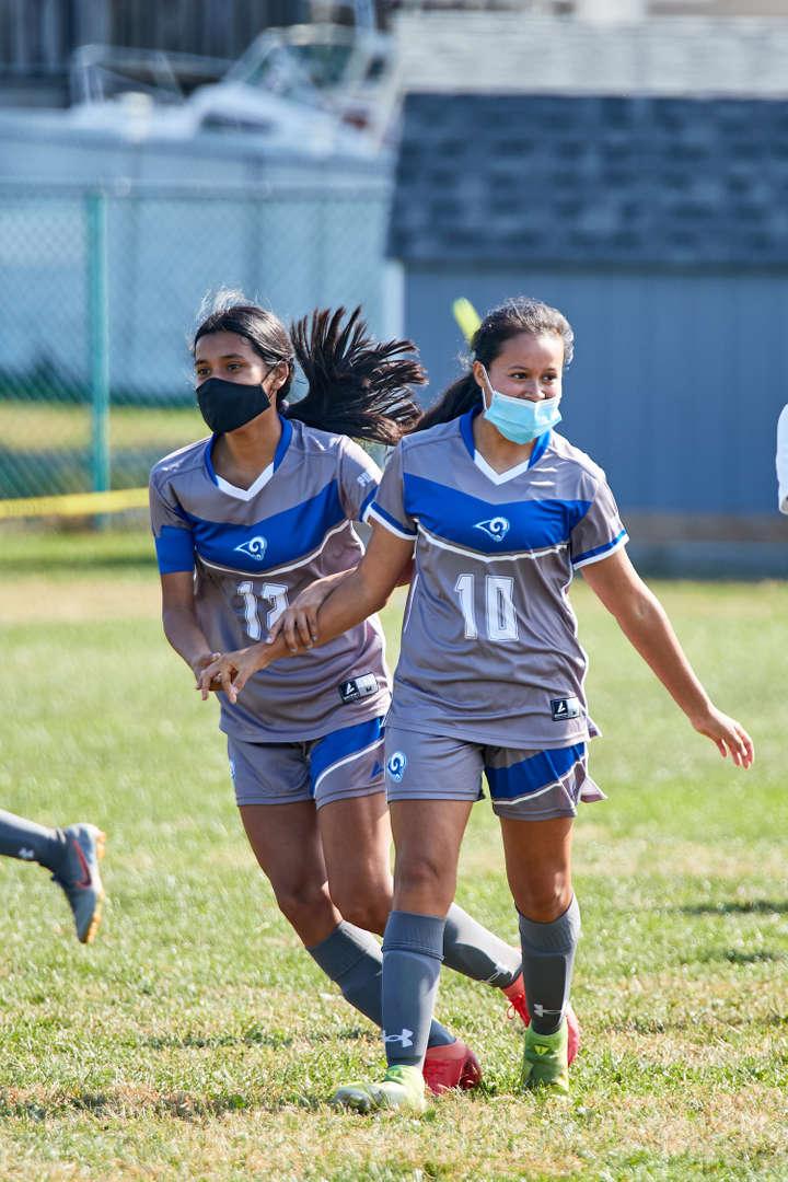 Two girls plaing soccer