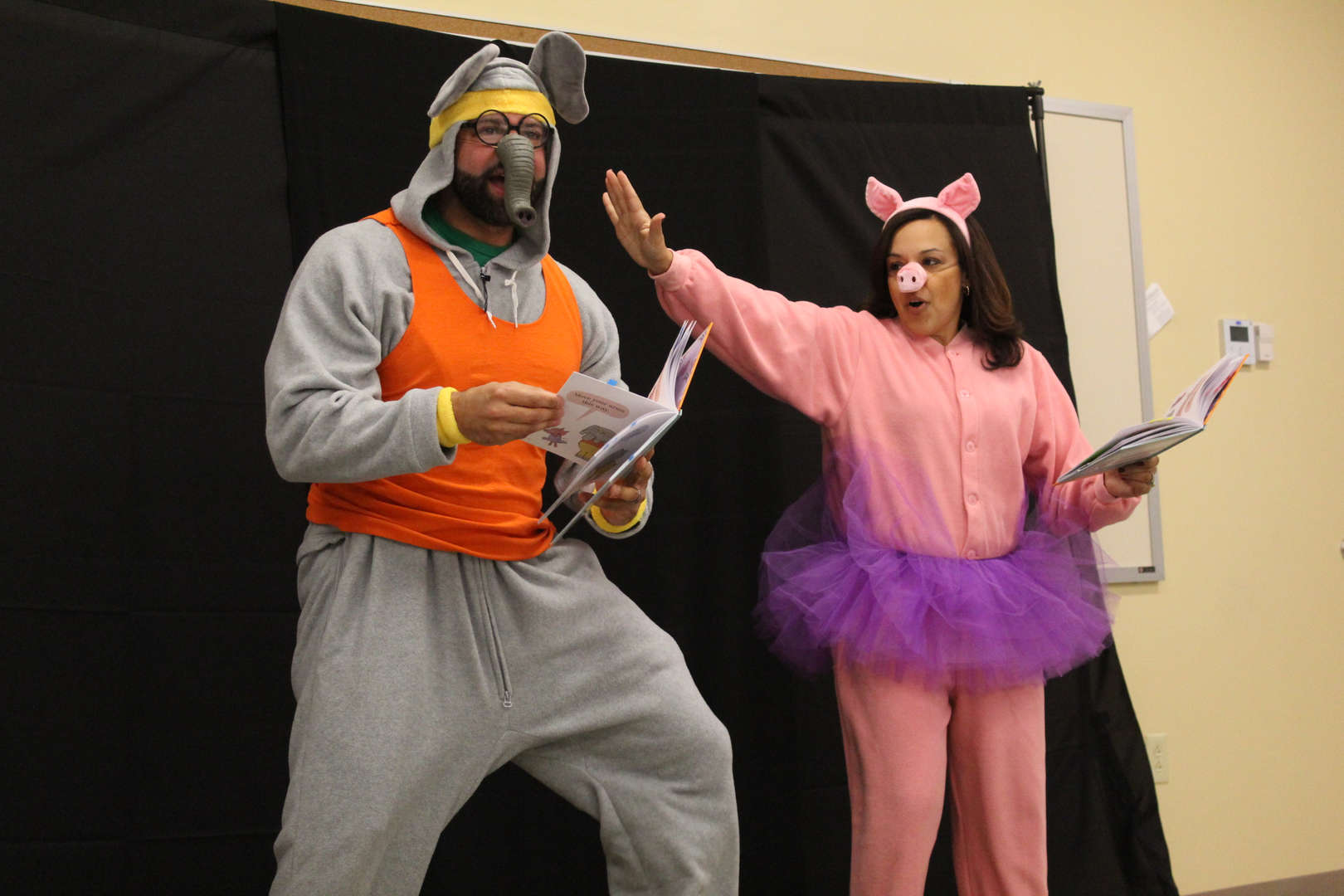 Actors dressed as an elephant and pig