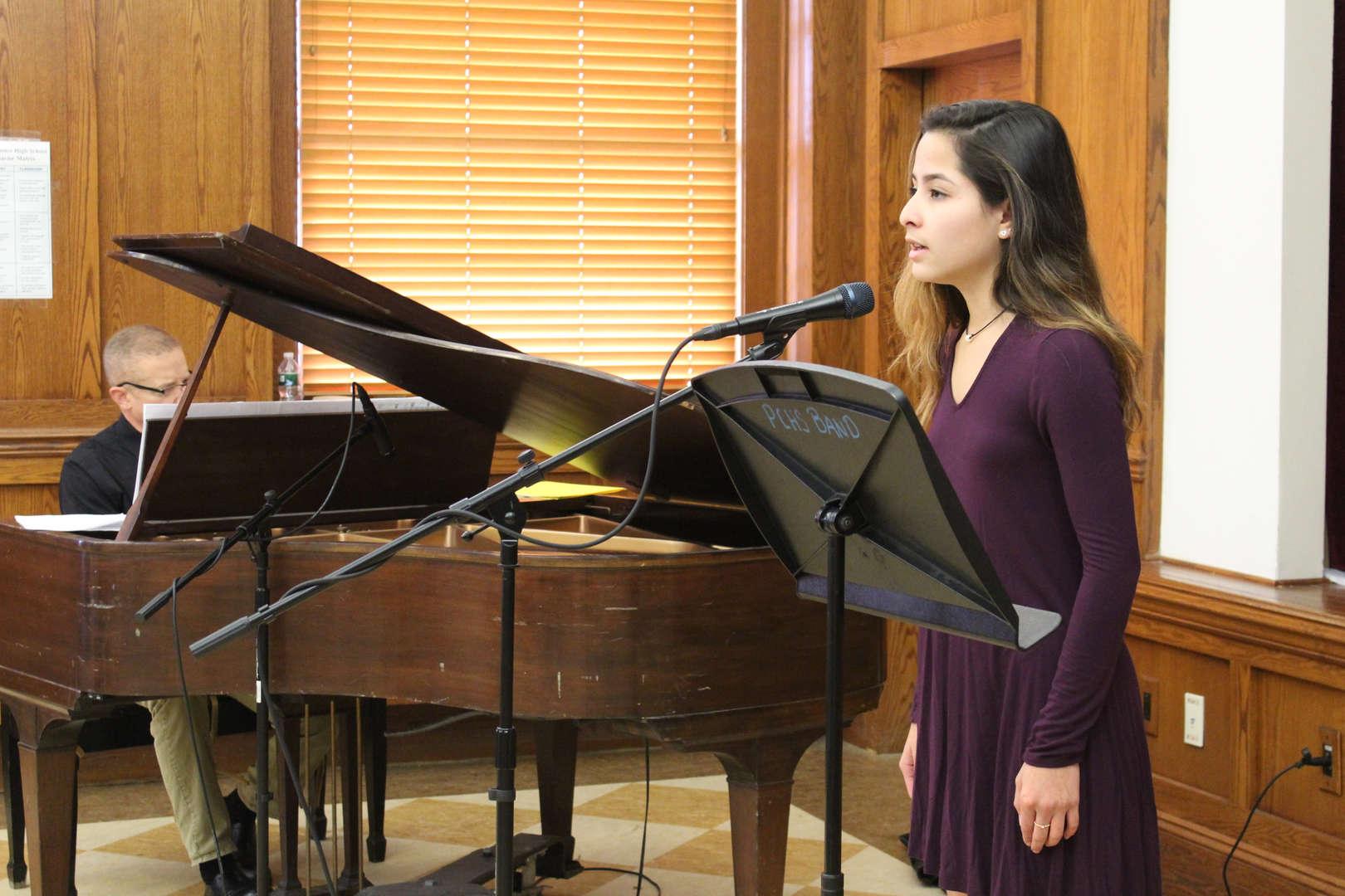 Girl standing singing