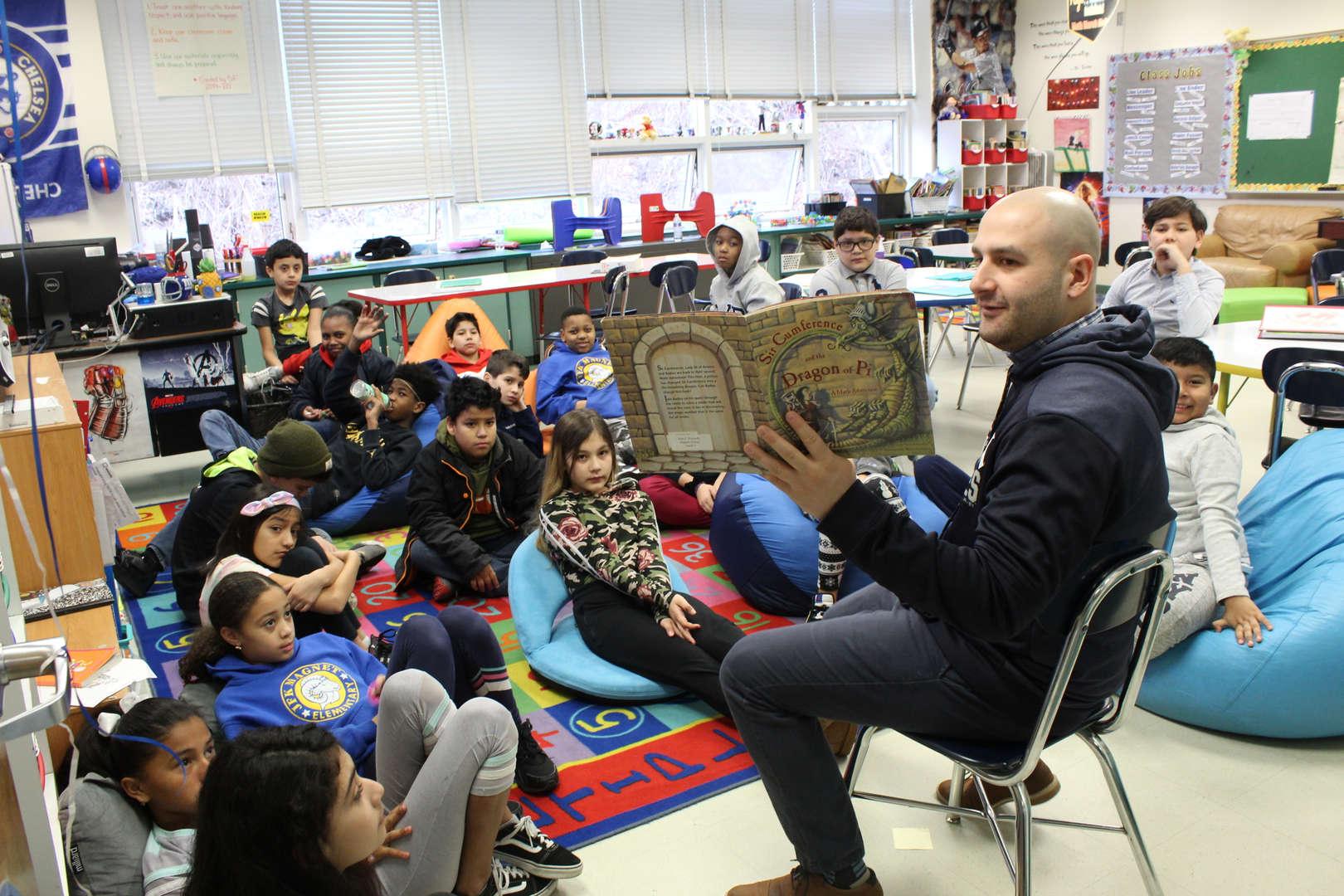 Man reads to children