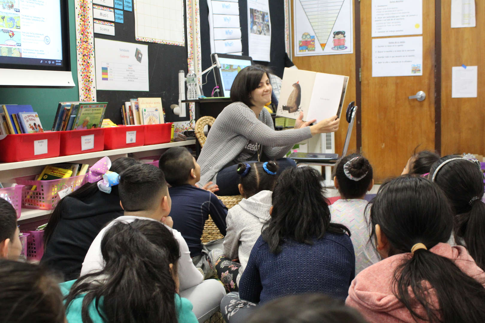 Woman reads to children