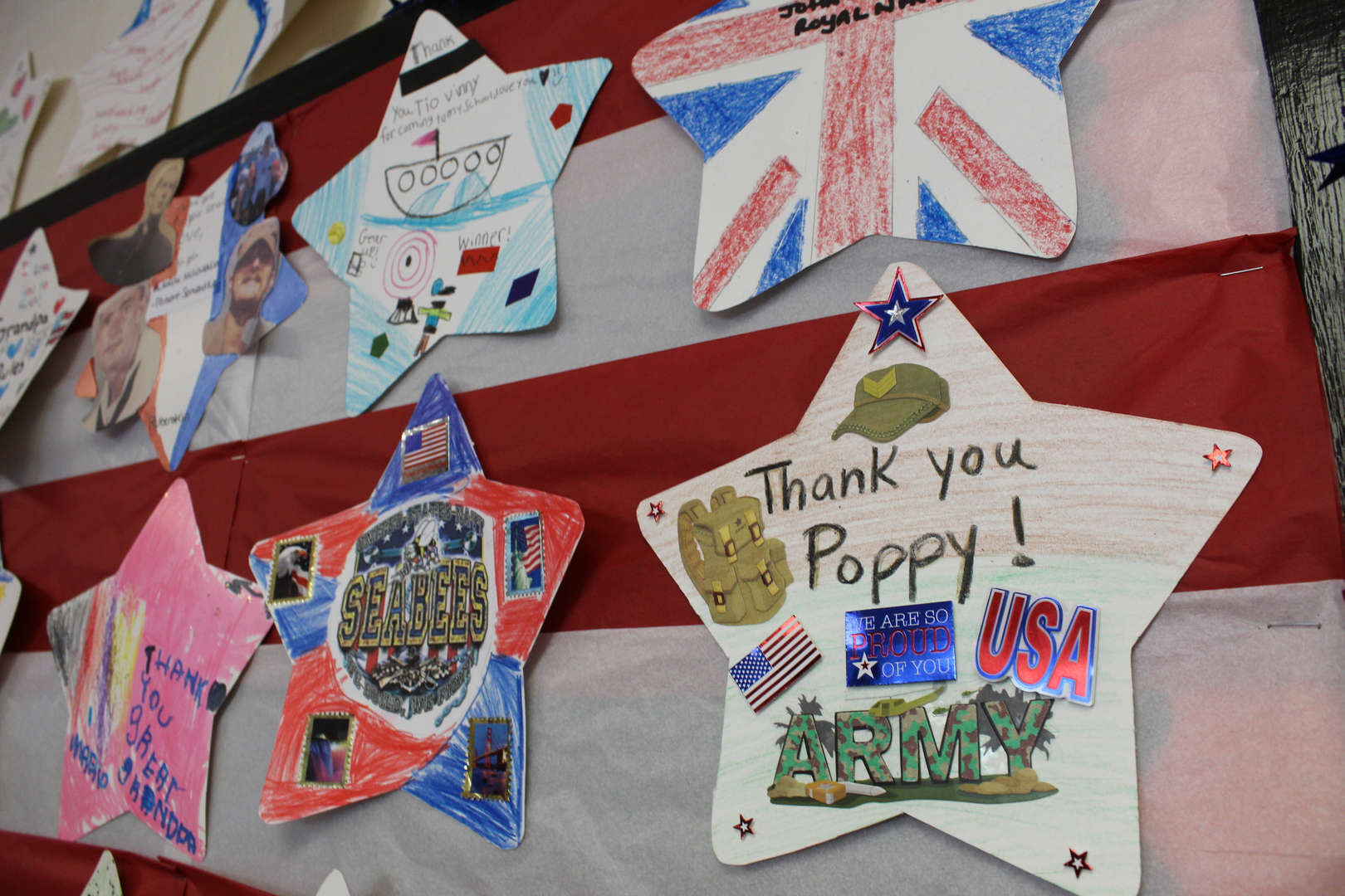 Paper stars with messages to veterans written on them