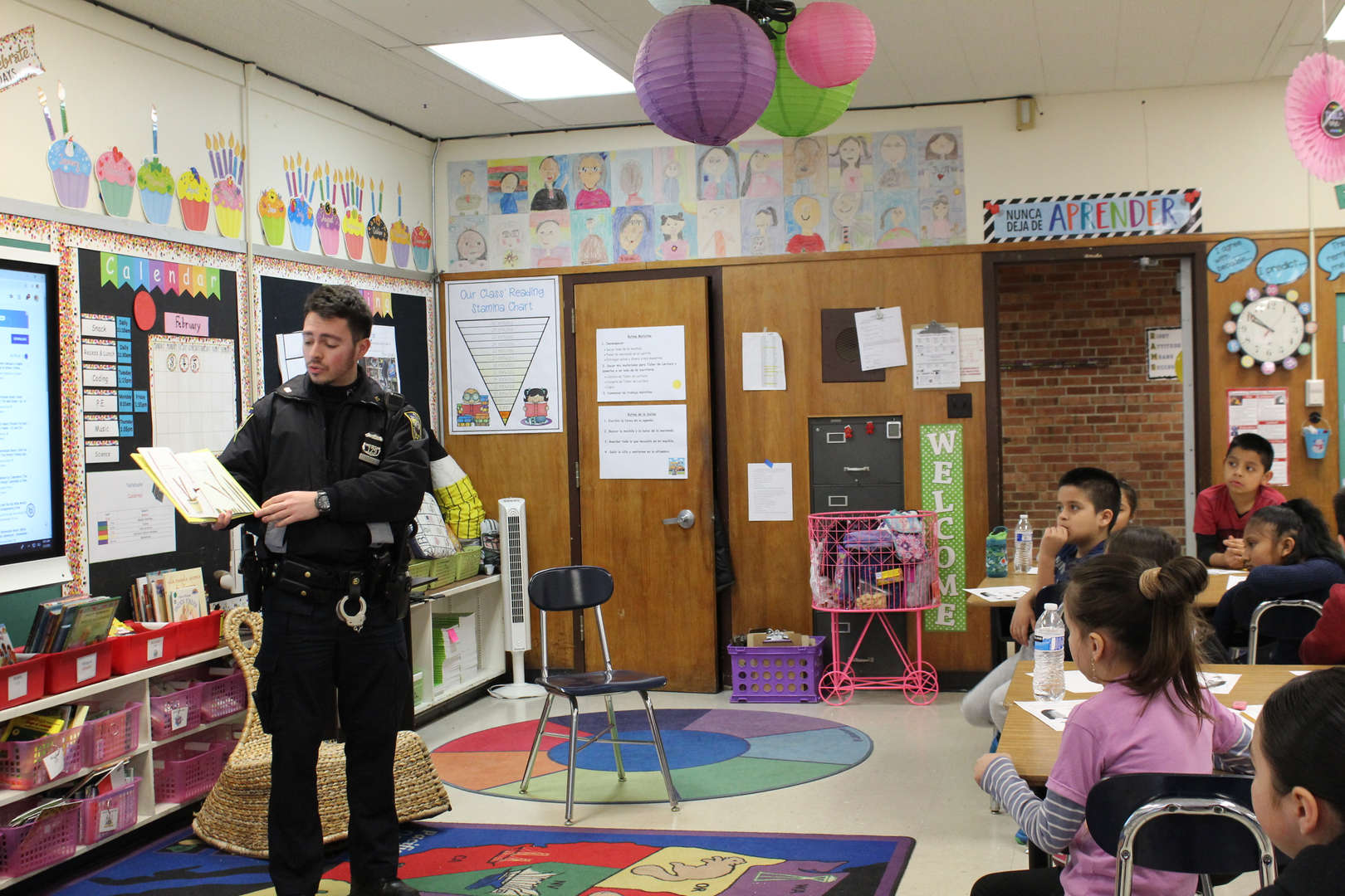 Police Officer reads to children