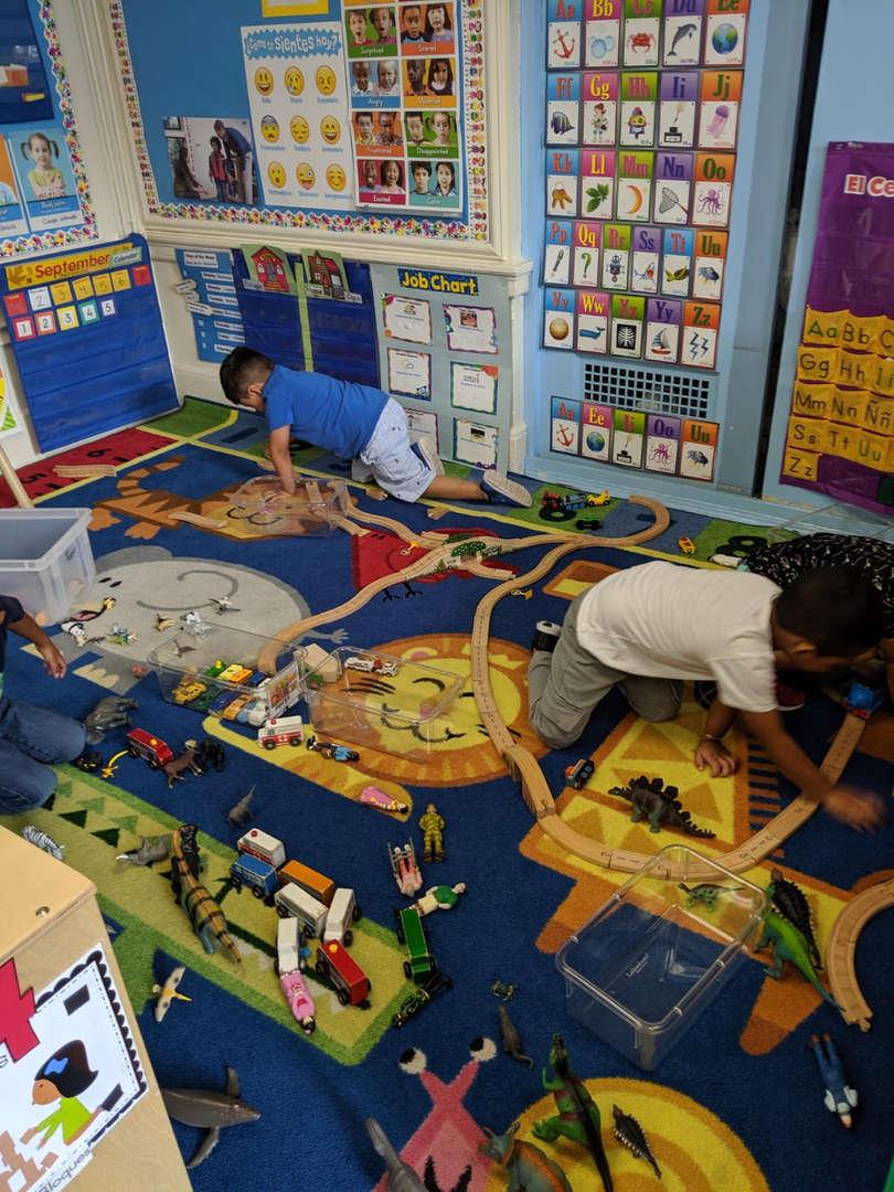 Children play on rug