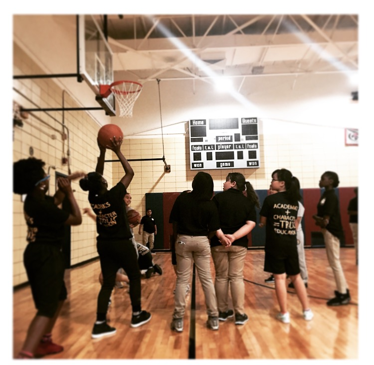 Scholars playing basketball at Vista Academy Gymnasium