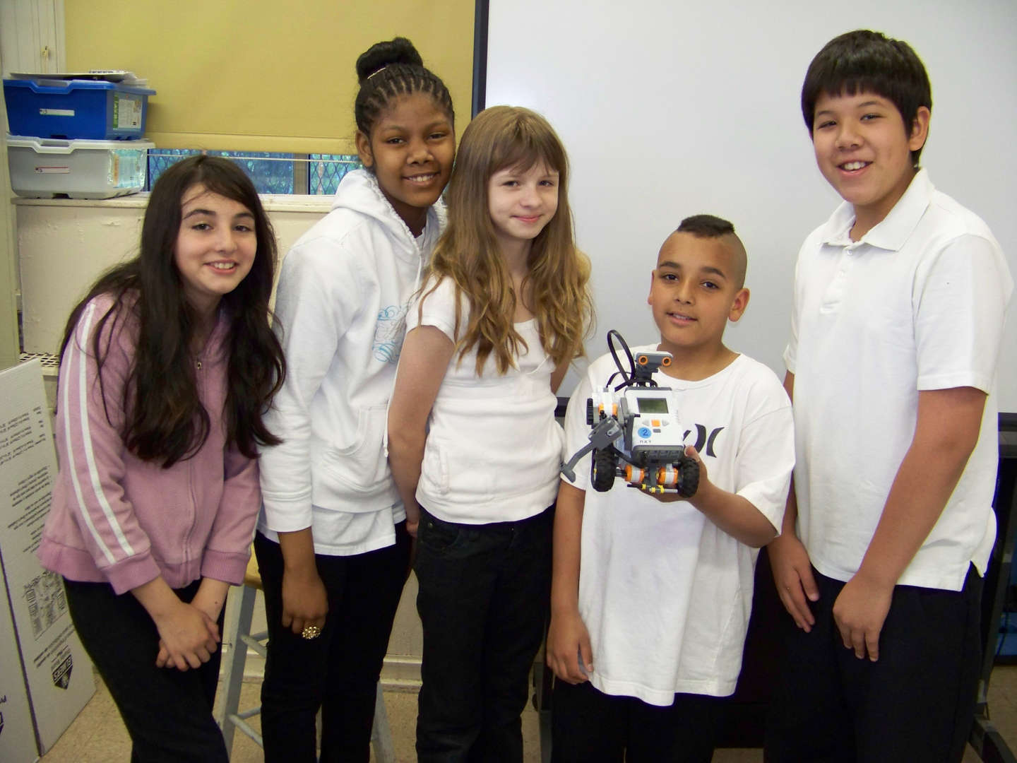 Students holding a Robot for Lego Robotics