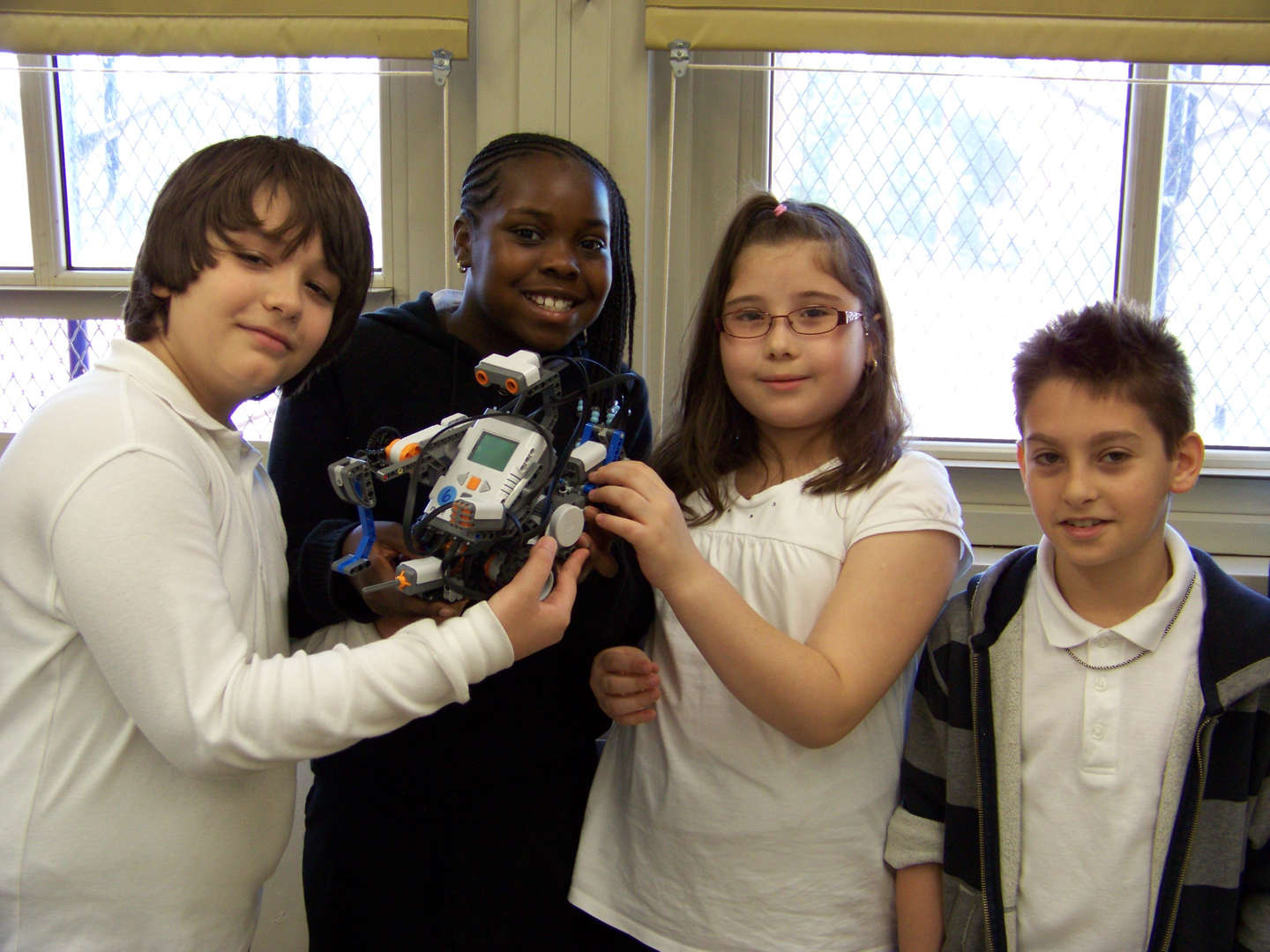 Students holding their Lego Robot