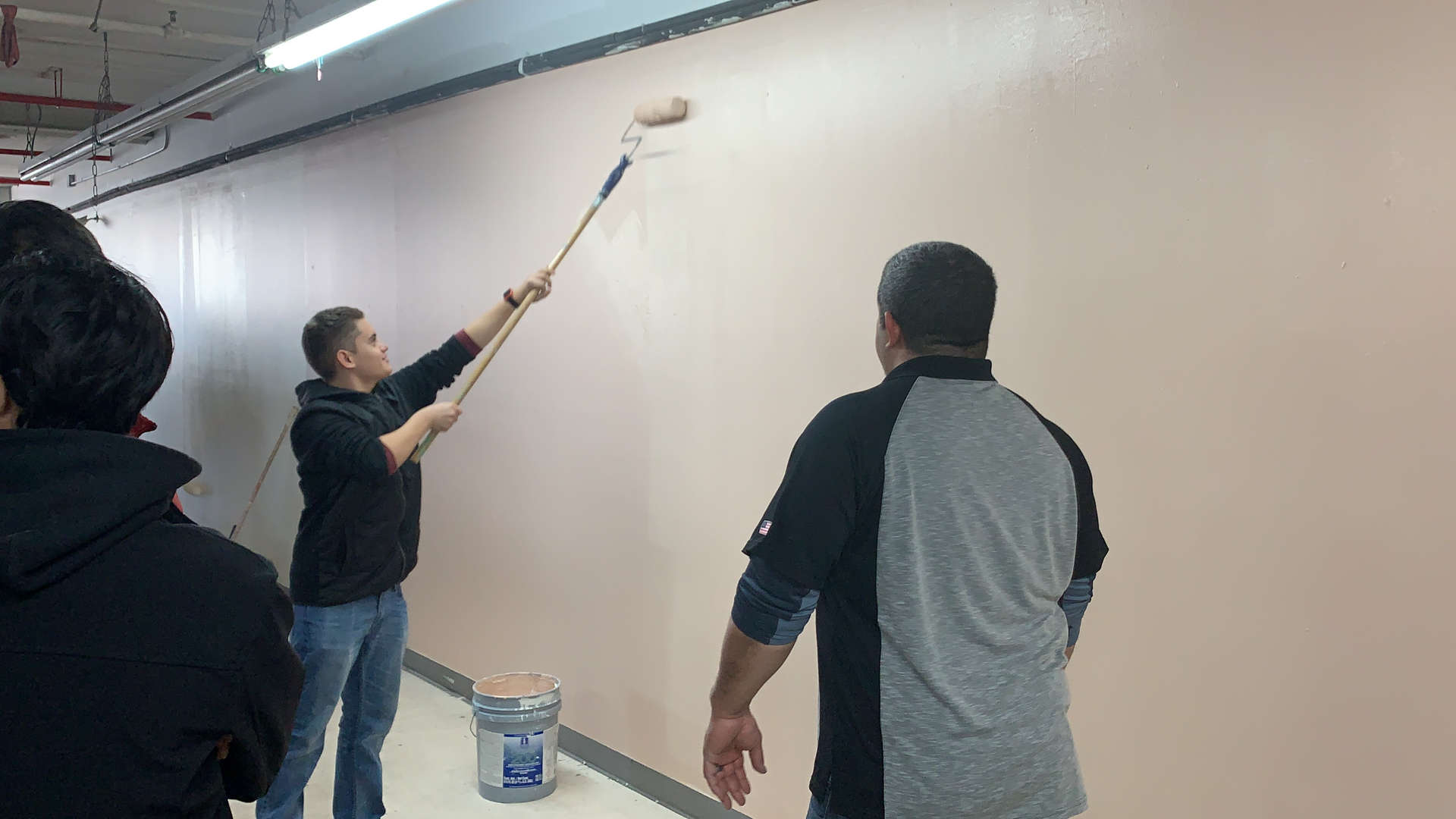 Students painting a hallway