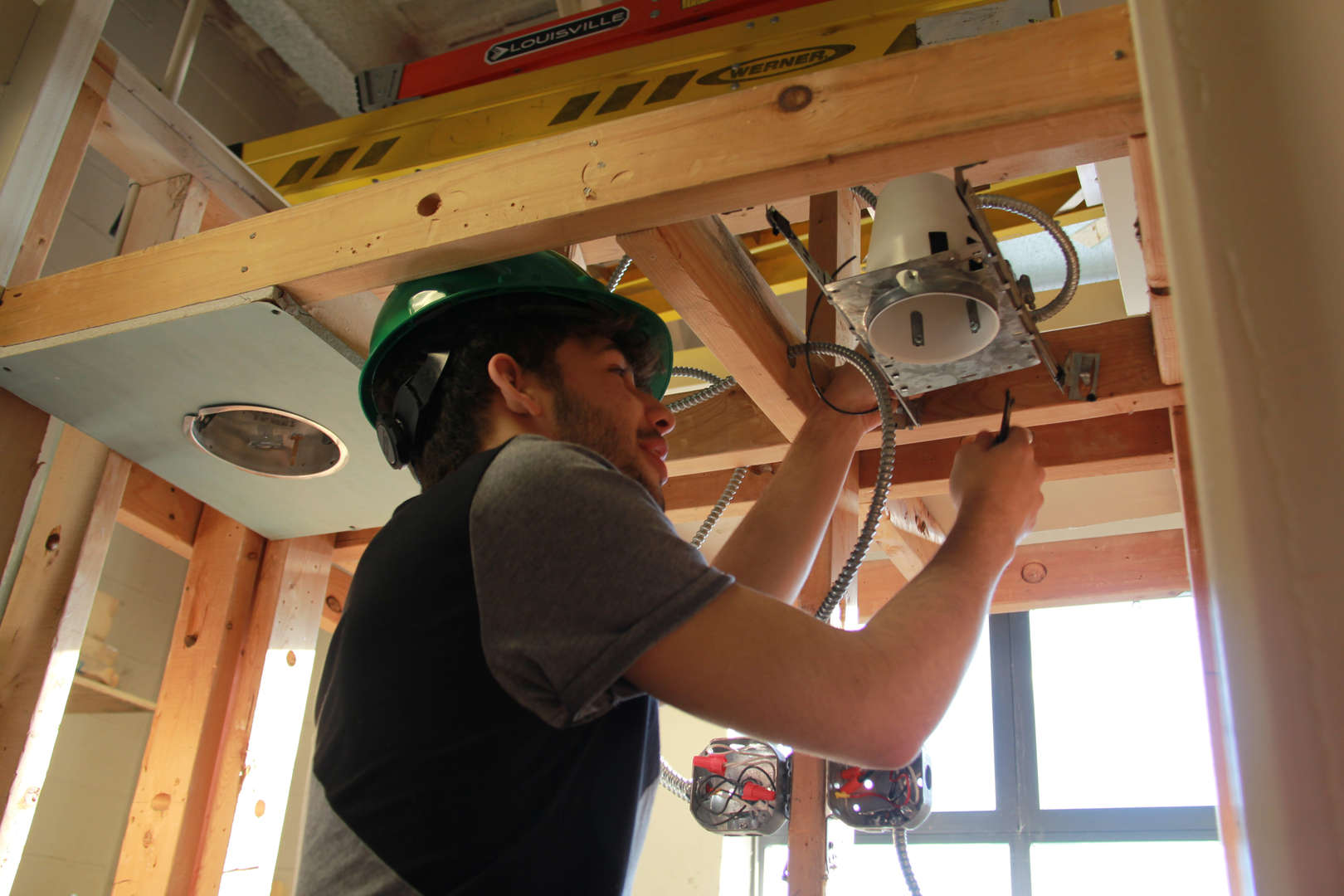 Student installing a light panel