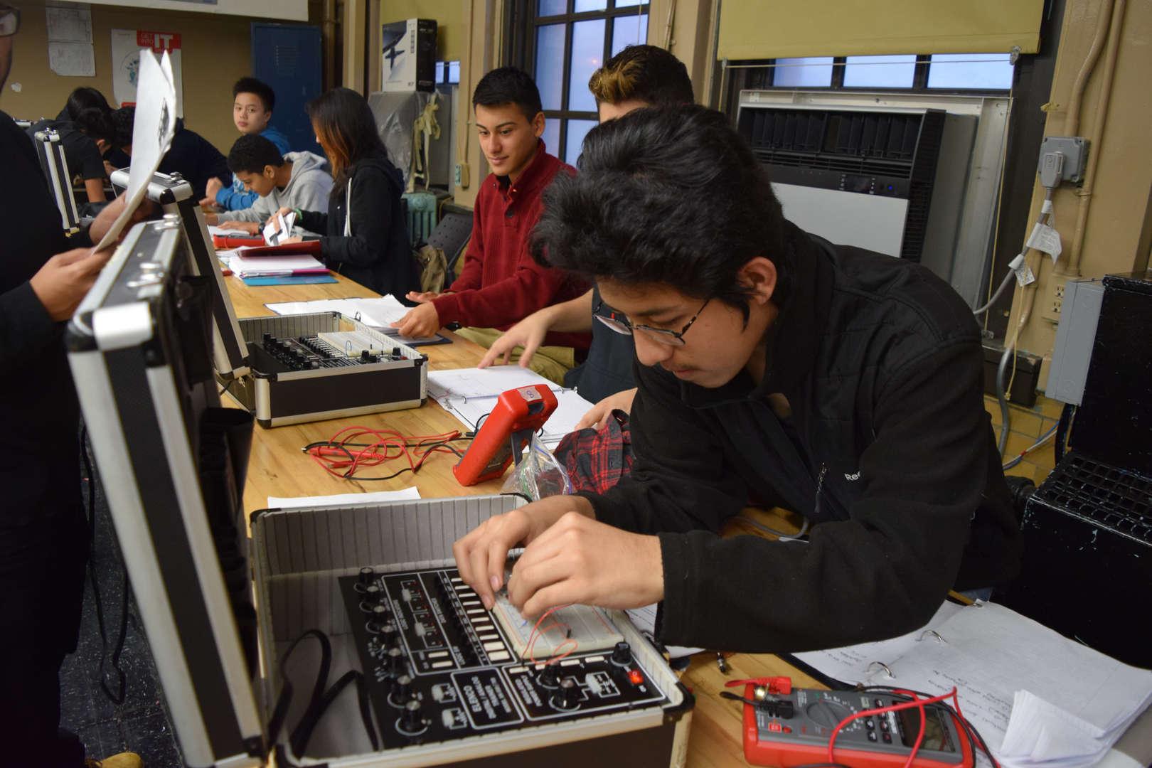 Student repairing a computer