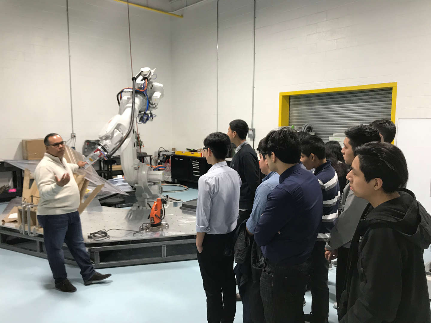 Students viewing robotic hardware