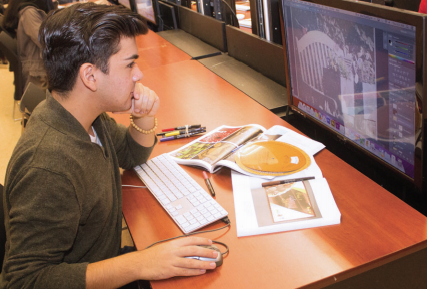 Student working in Adobe Photoshop