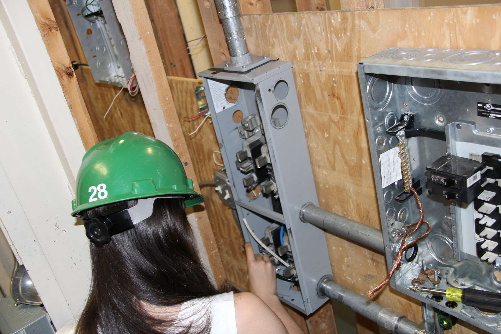 Student working on an electrical panel box