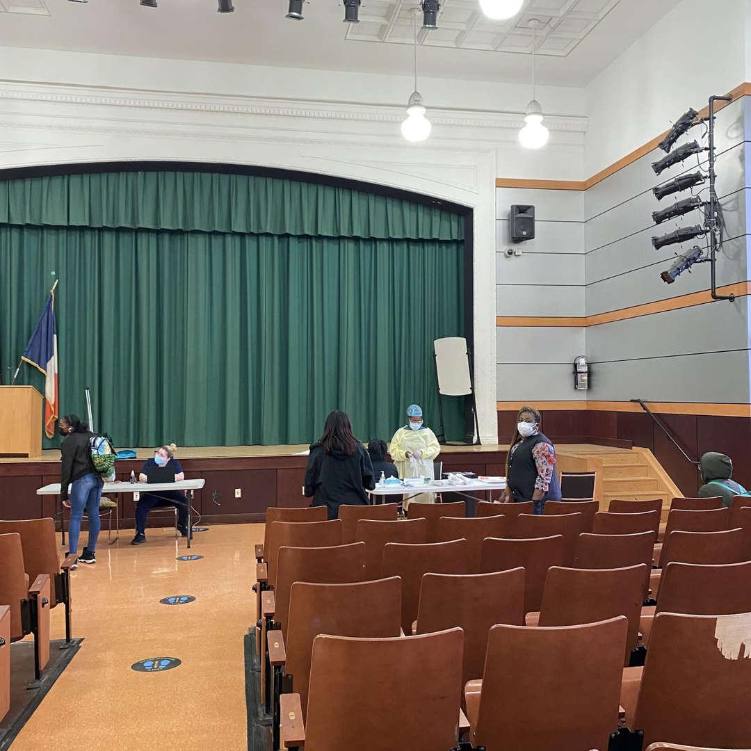 COVID testing in the Queens Tech auditorium