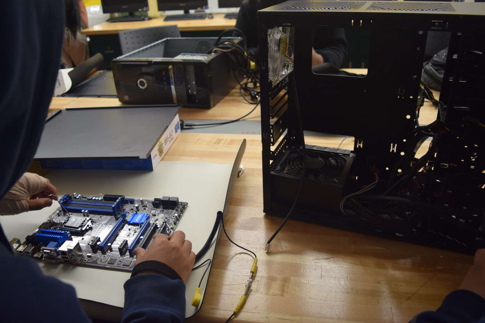 Student fixing a computer