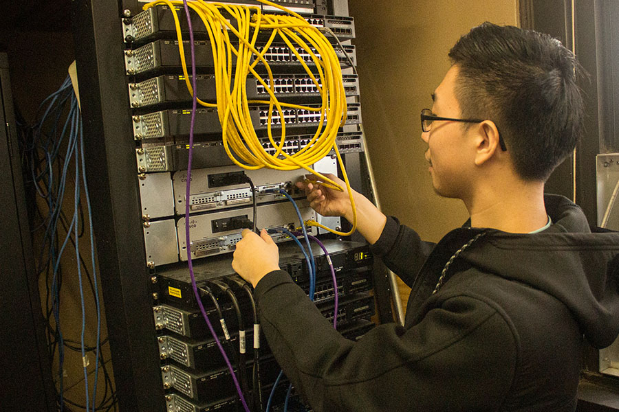 Student working on a computer networking switch