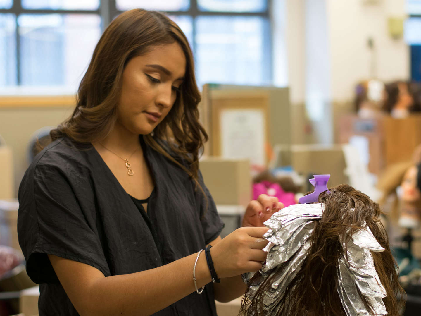 Student working in the cosmetology lab