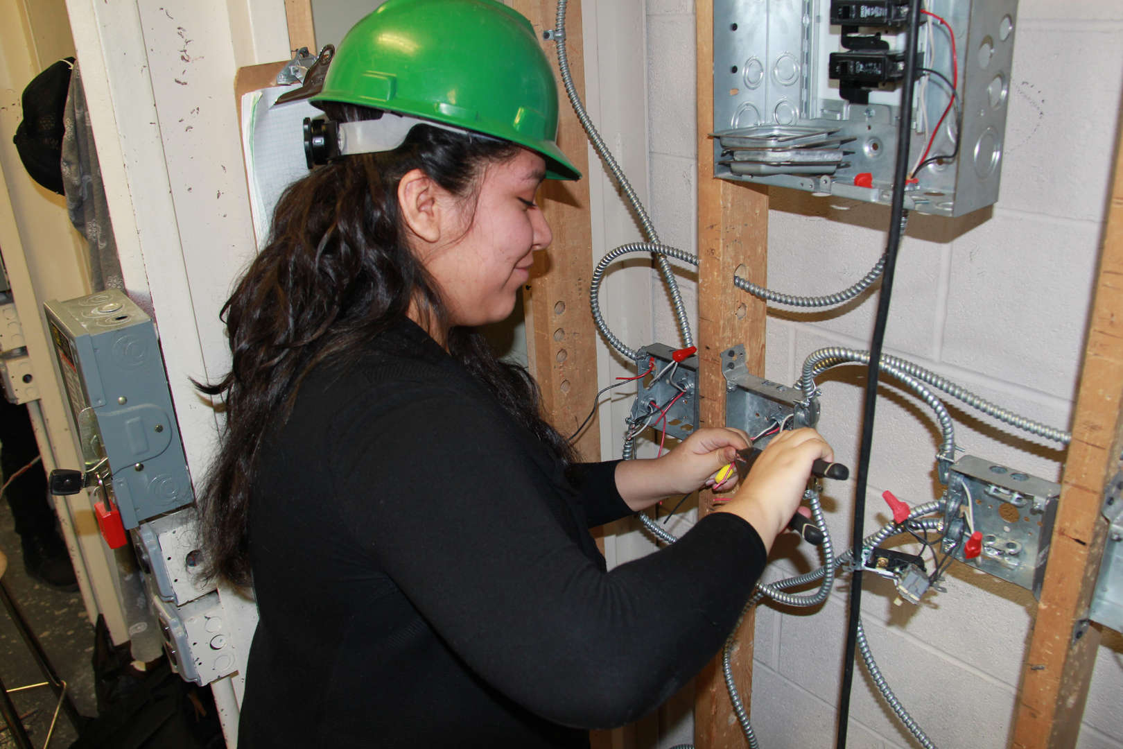 Student installing wiring