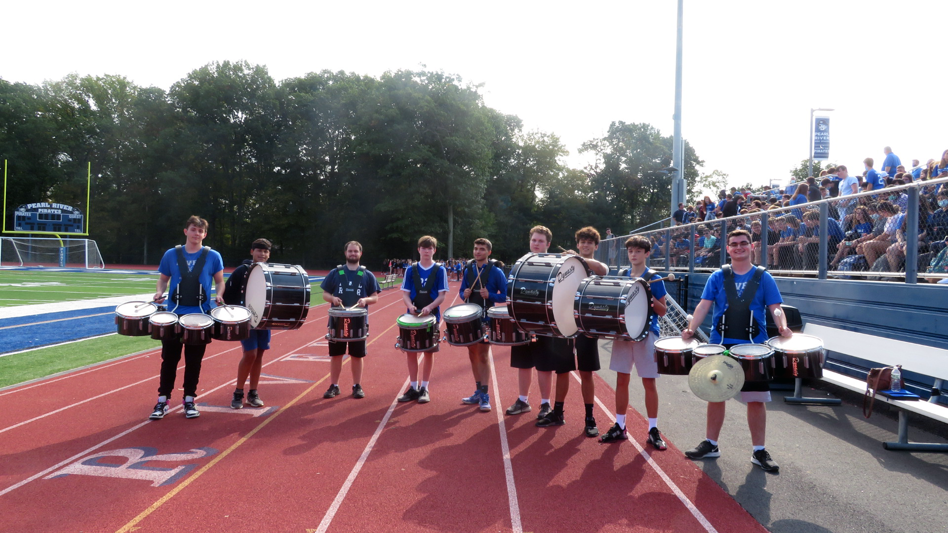 Band students pose at homecoming pep rally outdoors