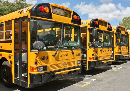 Yellow school buses parked in a line
