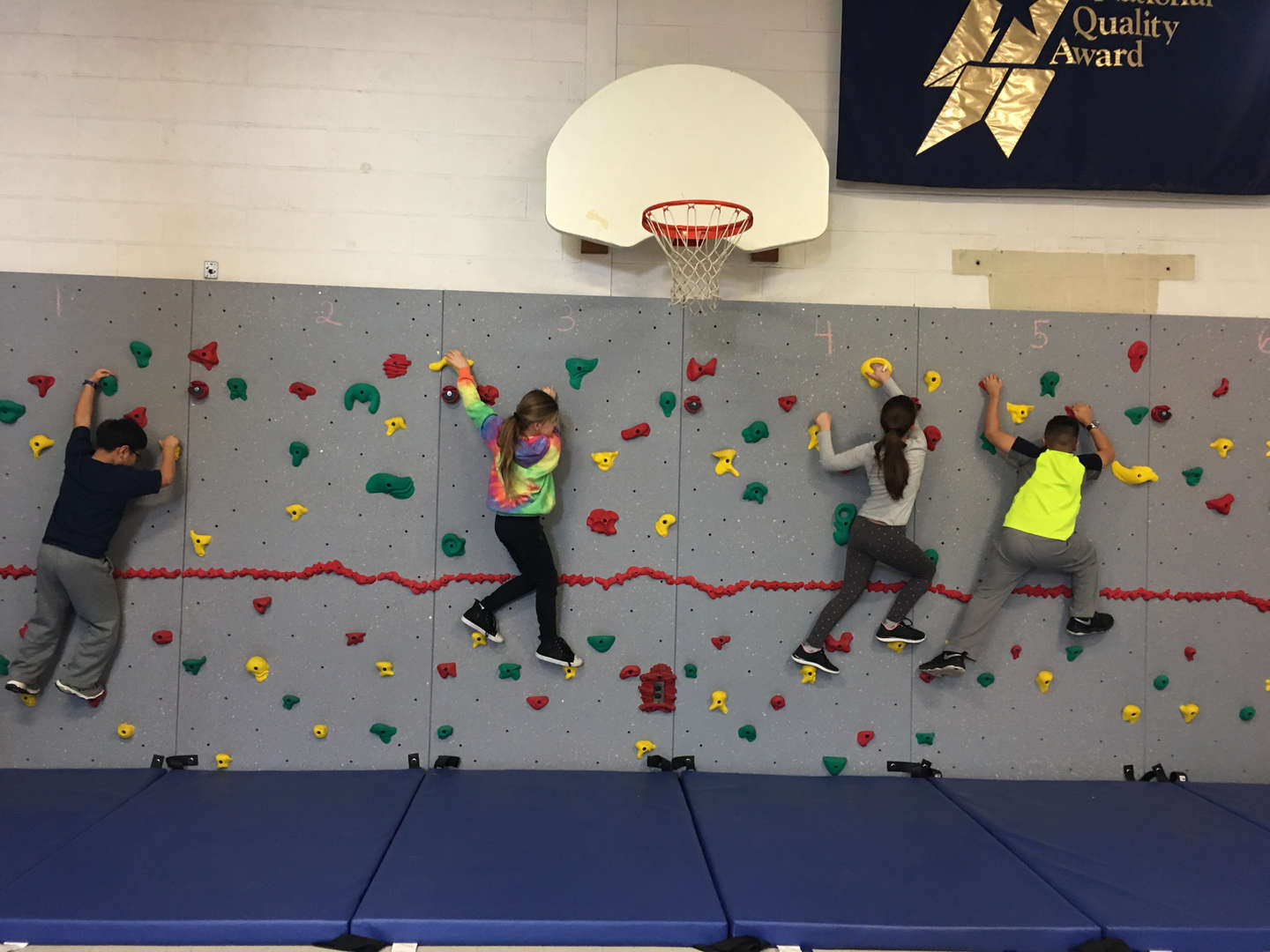 students wall climbing