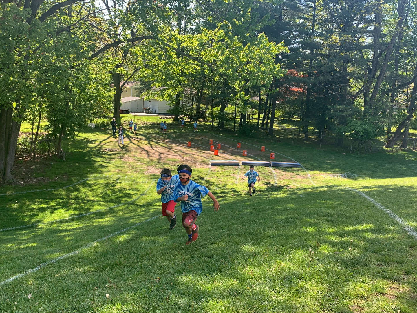 Students running obstacle course