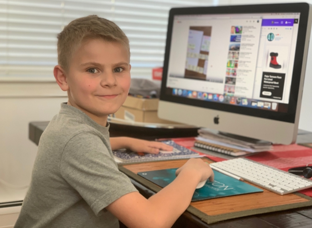 Second Grade student Working at Computer
