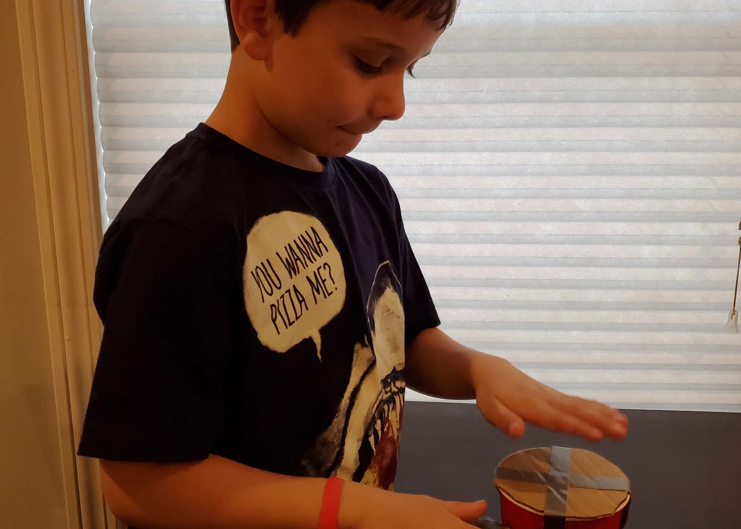 First Grade student with project