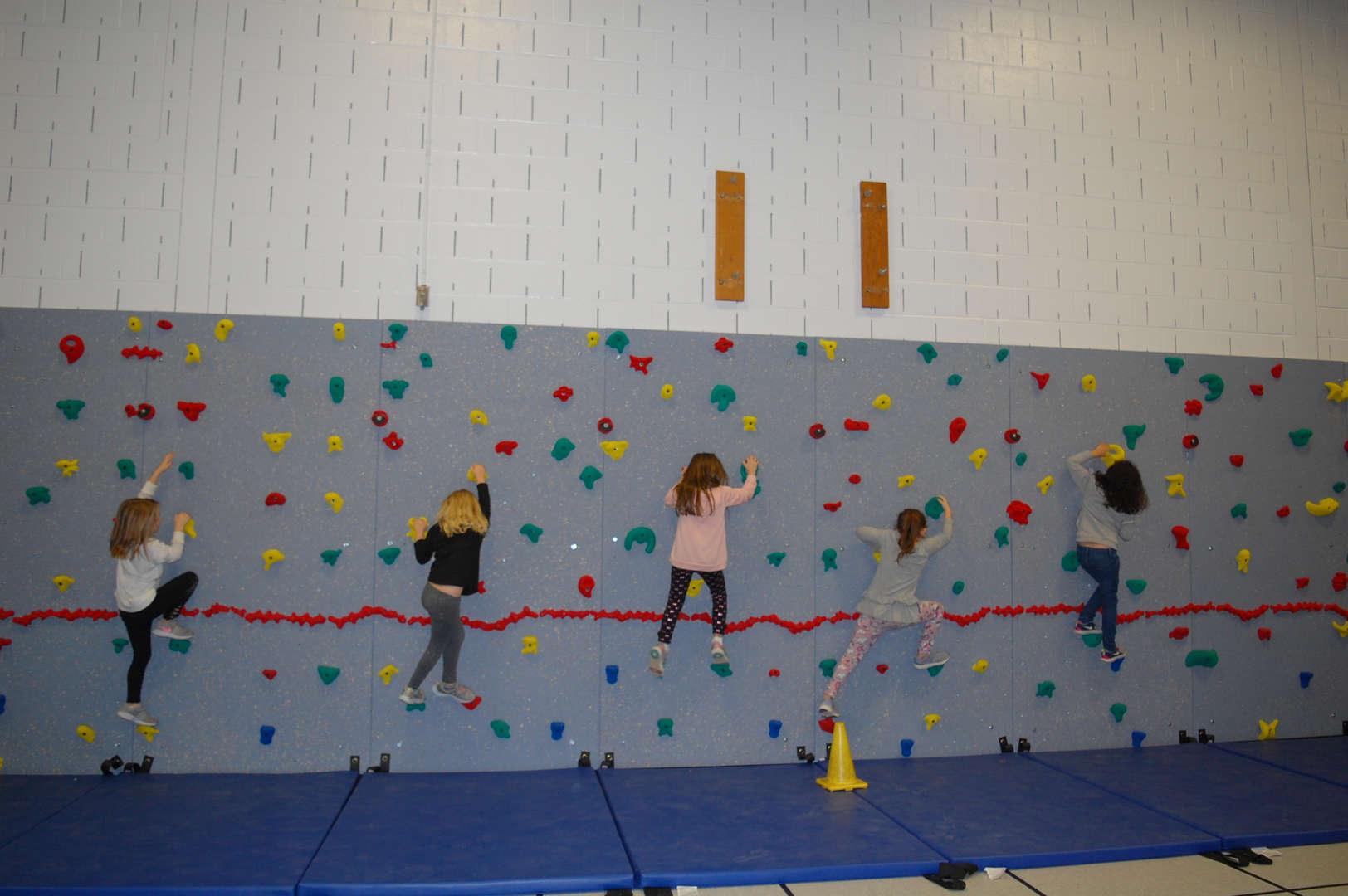 Children Climbing on Wall