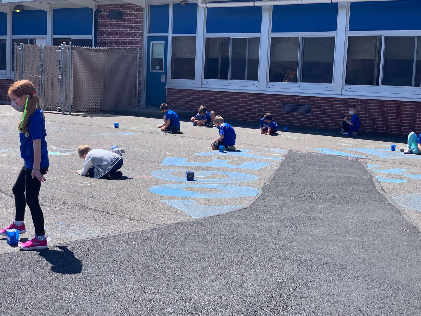 Kindergarteners Drawing with Chalk