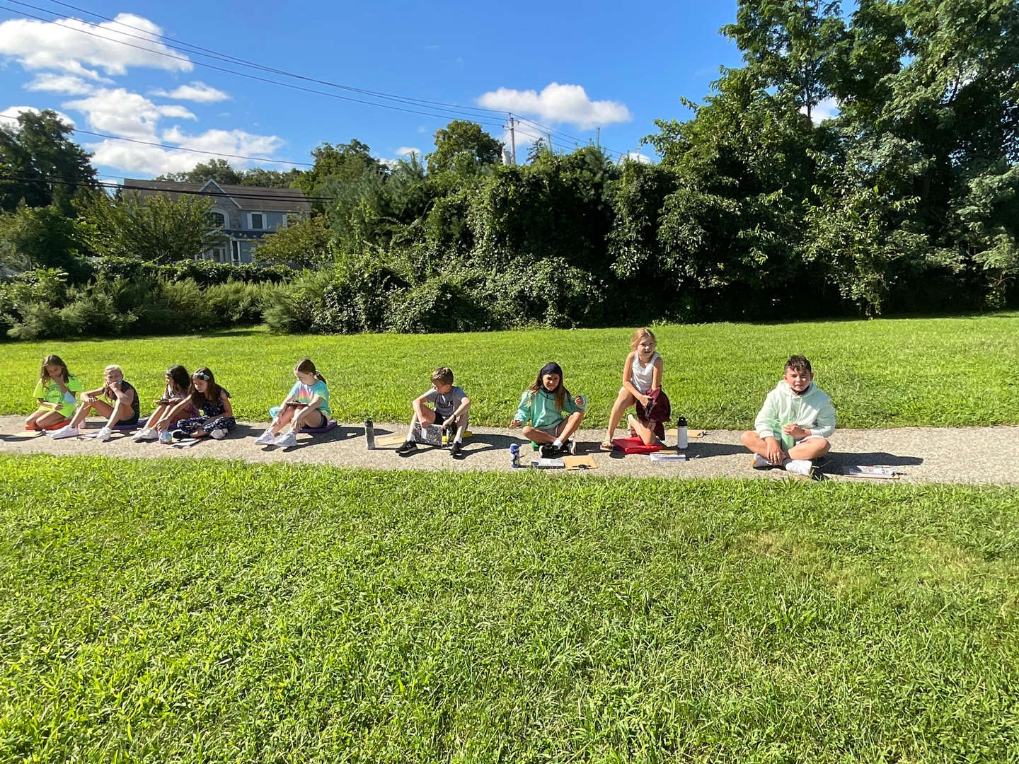Students eating snack outside