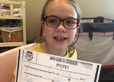 Student with Mad Libs Worksheet
