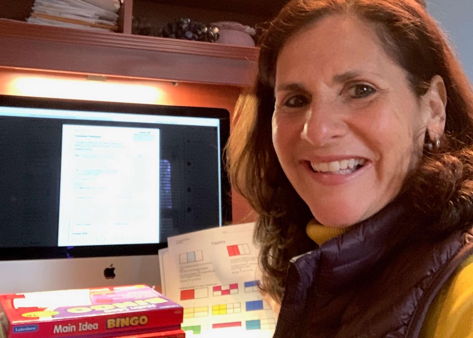 Resource Room Teacher working at computer