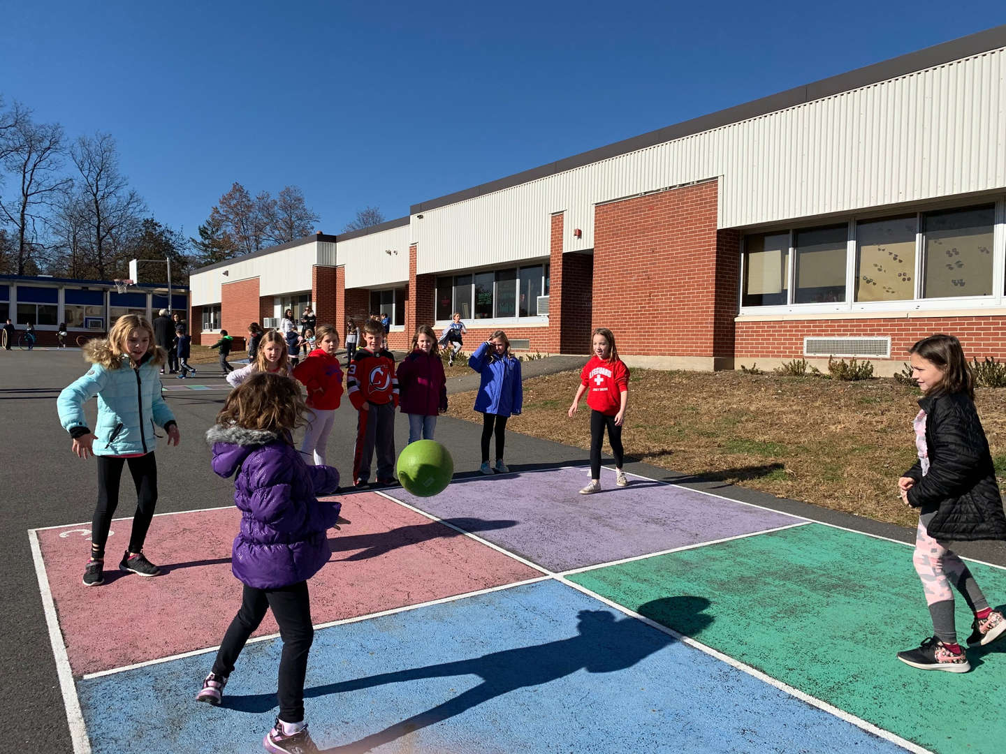 Children playing four square