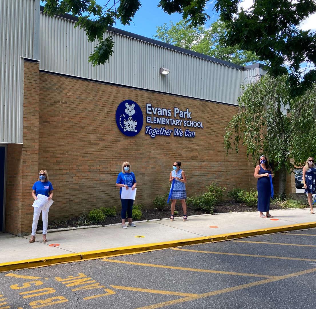 Teachers in front of school