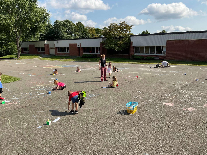 Class playing outside