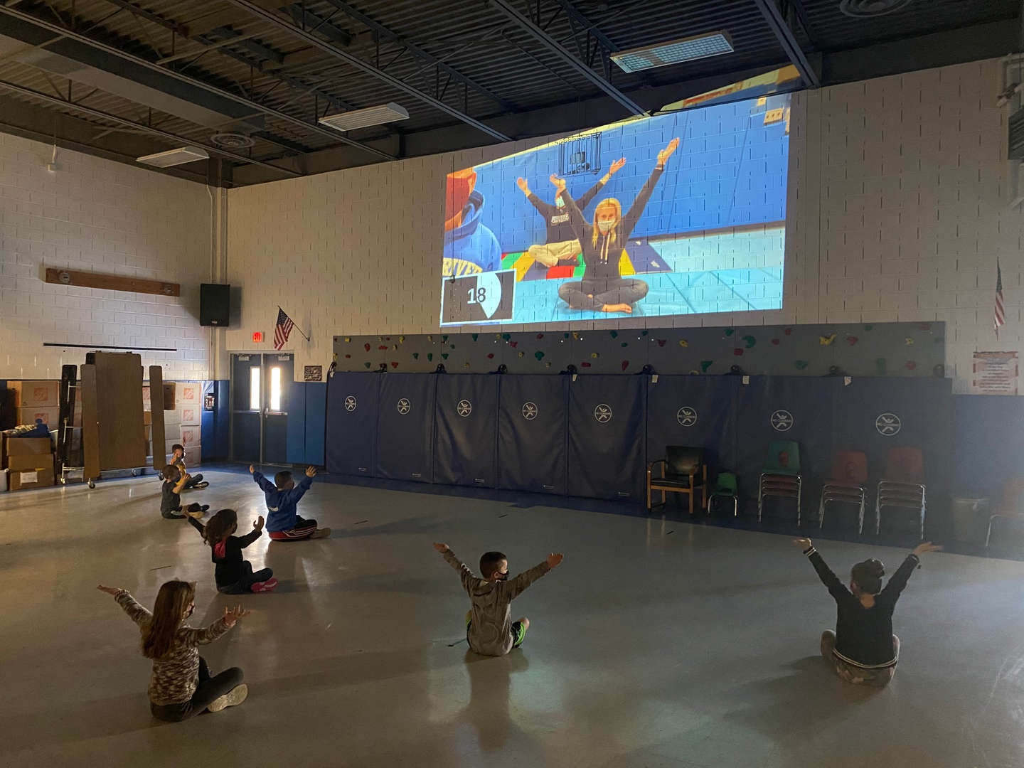 Kindergarten class doing seated yoga