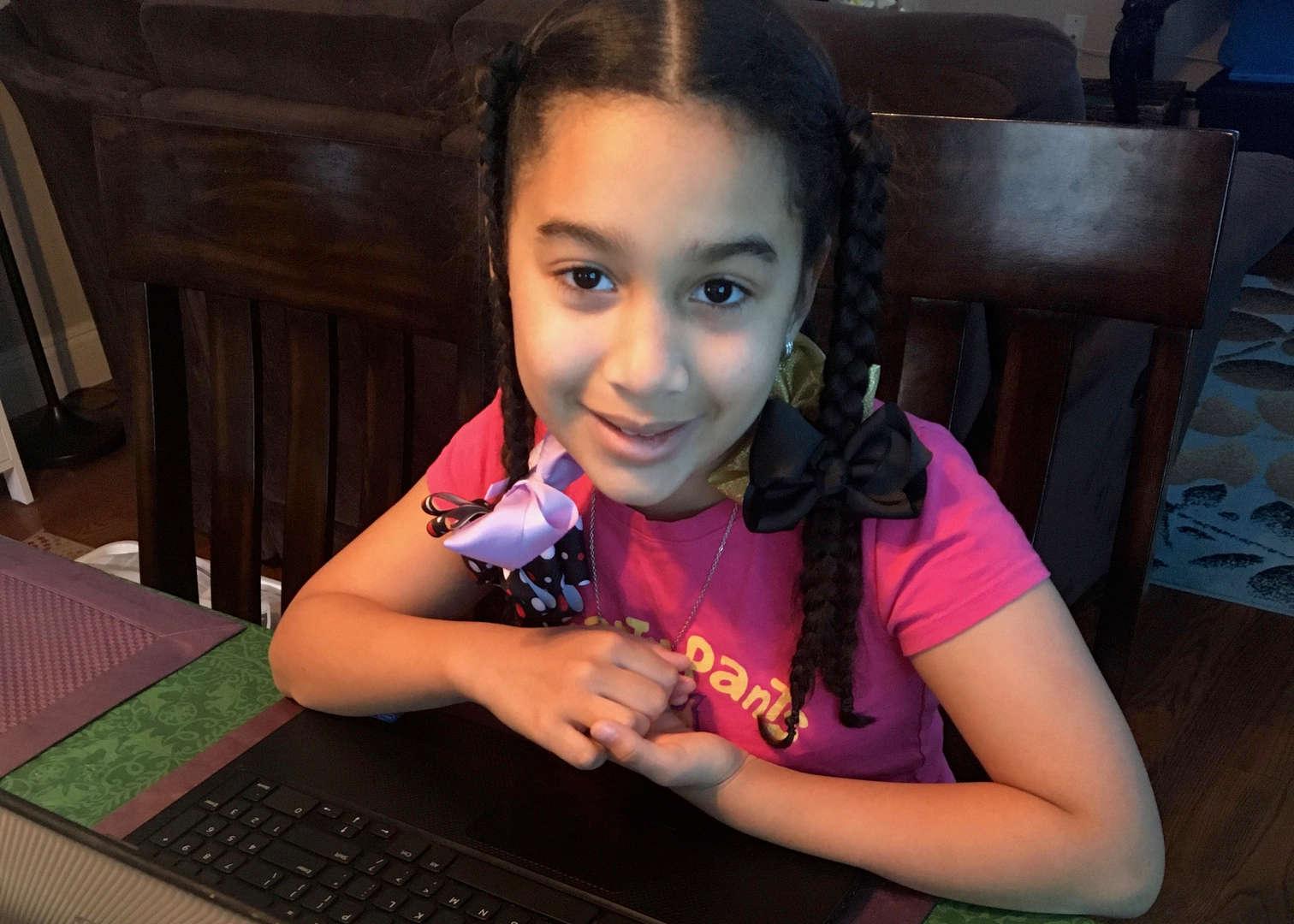 Female Student smiling at desk
