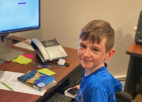Aidan C working at computer