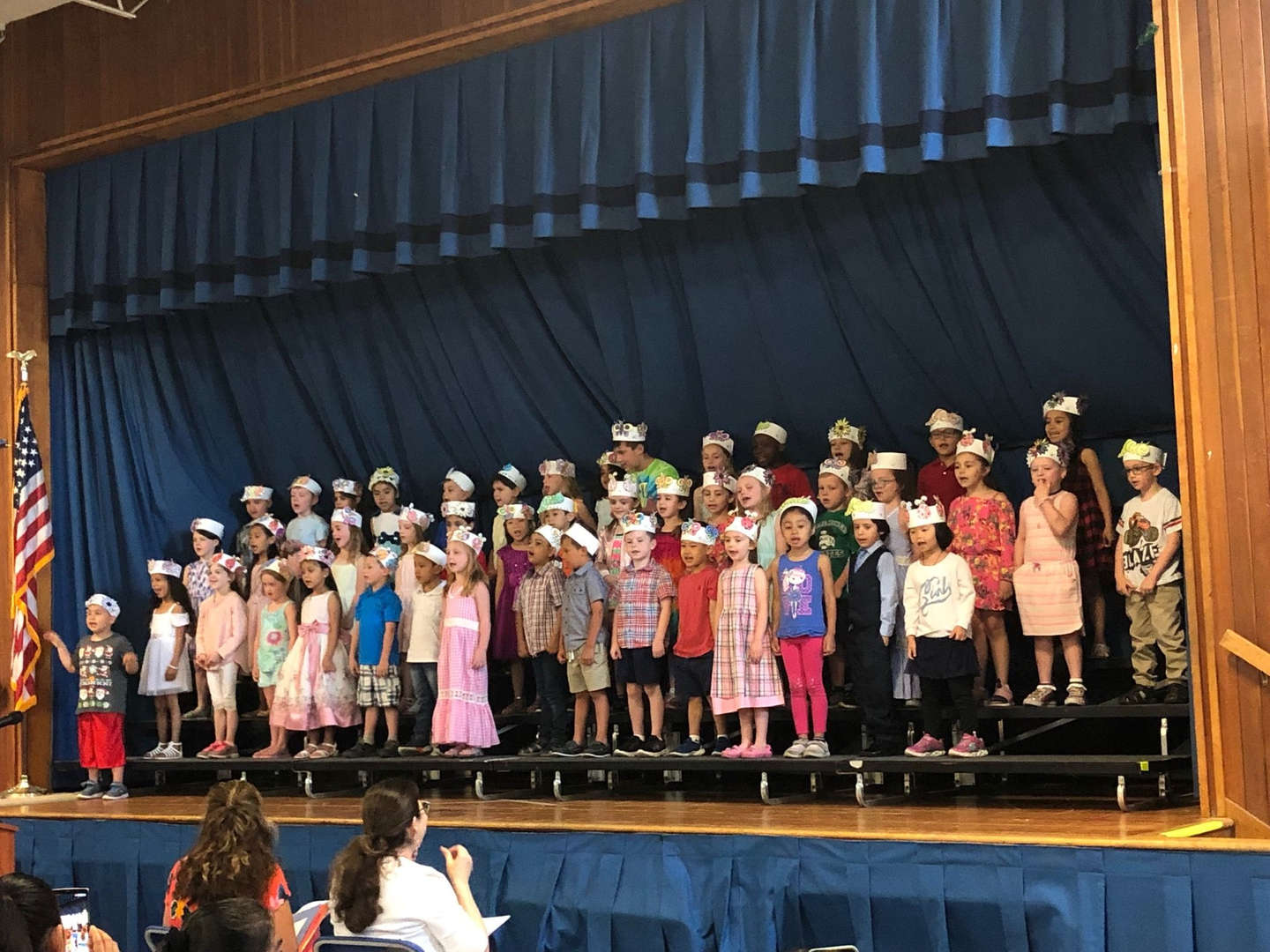 Forty-Six Kindergarten students standing on risers for their show.